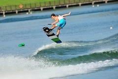 Athlete performing stunt during Rip Curl Singapore National Inter Varsity & Polytechnic Wakeboard Championship 2014. SINGAPORE - JULY 20: Athlete performing Stock Image