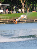 Athlete performing stunt during Rip Curl Singapore National Inter Varsity & Polytechnic Wakeboard Championship 2014 Stock Photography