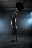 Athlete performs a barbell exercise Stock Photography