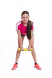 The athlete performs a forward bends with dumbbells Stock Photography