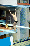 Athlete performs jump from springboard Stock Image