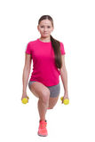 Athlete performs squats with dumbbells in his hands Royalty Free Stock Photography