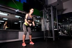 Athlete performs a strength exercise called crossover in the gym