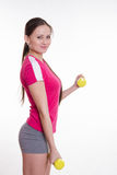 Athlete performs workout two dumbbells Royalty Free Stock Photo