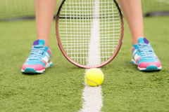Athlete playing tennis on field Stock Photo