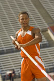 Athlete In Pole Vaulting Competition Stock Images