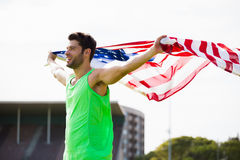 Athlete posing with american flag Stock Photography