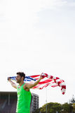 Athlete posing with american flag Stock Photo