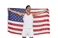 Athlete posing with american flag after victory Royalty Free Stock Photos
