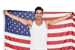Athlete posing with american flag after victory Royalty Free Stock Image