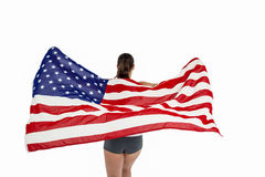 Athlete posing with american flag after victory Stock Image