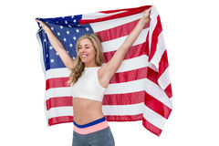 Athlete posing with american flag after victory Stock Photos