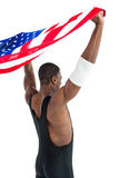 Athlete posing with american flag after victory Royalty Free Stock Photography