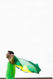 Athlete posing with brazilian flag after victory royalty free stock photo