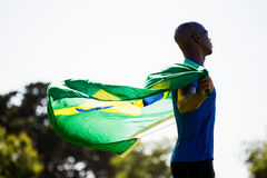 Athlete posing with brazilian flag after victory Royalty Free Stock Photography