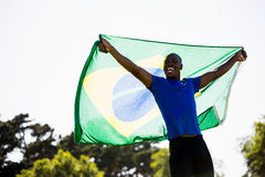 Athlete posing with brazilian flag after victory Royalty Free Stock Images