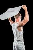 Athlete posing with flag Stock Photo