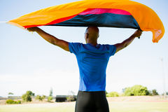 Athlete posing with german flag after victory Royalty Free Stock Image
