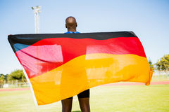 Athlete posing with german flag after victory Royalty Free Stock Photography