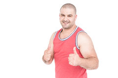 Athlete posing and giving a thumbs up Royalty Free Stock Image