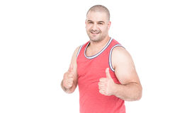 Athlete posing and giving a thumbs up Stock Photo