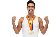 Athlete posing with gold medal after victory Stock Image