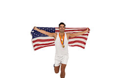 Athlete posing with gold medals and american flag after victory Stock Photo
