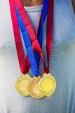 Athlete posing with gold medals around his neck Royalty Free Stock Image
