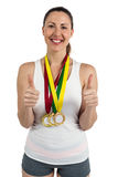 Athlete posing with gold medals around his neck Royalty Free Stock Images