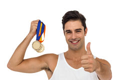 Athlete posing with gold medals Royalty Free Stock Photo
