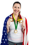Athlete posing with gold medals after victory Stock Image