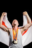 Athlete posing with gold medals after victory Royalty Free Stock Photos