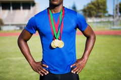 Athlete posing with gold medals after victory Stock Photo