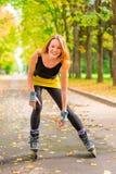 Athlete posing on skates in the autumn park Stock Photography