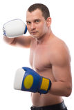 Athlete posing on a white background with a naked torso royalty free stock photography