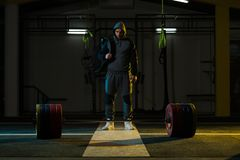 Athlete of Powerlifter Attempt Deadlift a Heavy Barbell royalty free stock image