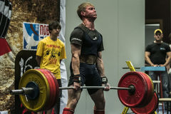 Athlete of powerlifter performs a deadlift Stock Images