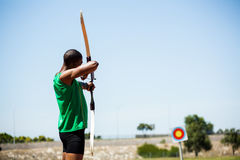 Athlete practicing archery royalty free stock photos