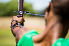 Athlete practicing archery royalty free stock image