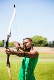 Athlete practicing archery royalty free stock photo