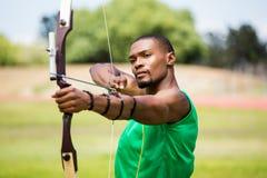 Athlete practicing archery royalty free stock photos