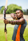 Athlete practicing archery royalty free stock images