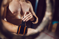 Athlete prepare for exercise on rings Stock Images