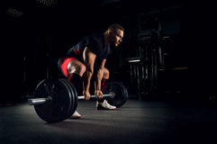 Athlete is prepared to perform an exercise called deadlift. Athlete in the gym is prepared to perform an exercise called deadlift Stock Images