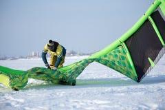 The athlete prepares the kite for riding Stock Photos