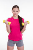 The athlete pumps weights both hands Stock Image