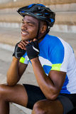 Athlete putting on cycling helmet Royalty Free Stock Image