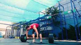 The athlete raise up the barbell stock video