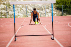 Athlete ready to jump a hurdle Stock Photography
