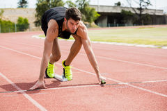 Athlete ready to start the relay race Royalty Free Stock Photography